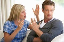 Young Couple Having Argument At Home