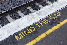 Mind the gap sign on a railway platform