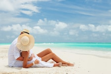 Couple on the beach at the ocean