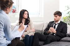 couple with therapist who confronts financial irresponsibility
